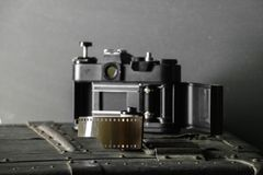 Old retro camera and 35 mm Royalty Free Stock Photography