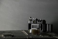 Old retro camera and 35 mm Royalty Free Stock Image