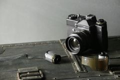 Old retro camera and 35 mm. Film in cartridge on a vintage background Royalty Free Stock Image