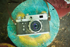 Old retro camera. On the stump stock photography