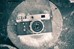Old retro camera. On the stump royalty free stock photos