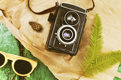 Old retro camera with sunglasses abstract background Royalty Free Stock Photography