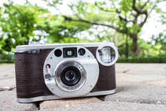 Old retro camera vintage  with bokeh background abstract Royalty Free Stock Photo