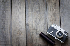 Old retro camera on vintage wooden boards Royalty Free Stock Photo