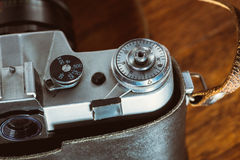 Old retro camera on vintage wooden boards abstract background Royalty Free Stock Photos