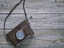Old retro camera. On vintage wooden boards abstract background Royalty Free Stock Photography