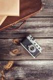 Old retro camera on vintage wooden boards Stock Photos