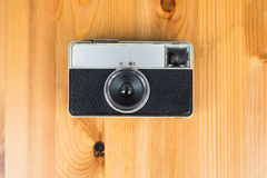 Old retro camera on vintage wooden boards abstract background Stock Images