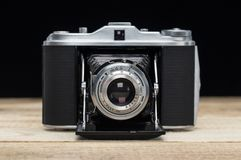 Old retro camera on vintage wooden boards stock photos