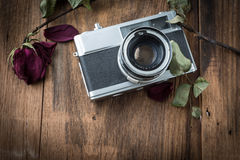 Old retro camera on vintage wooden boards Royalty Free Stock Image