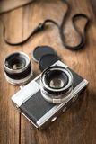 Old retro camera on vintage wooden boards Royalty Free Stock Images