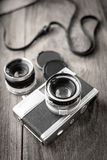 Old retro camera on vintage wooden boards Stock Photo