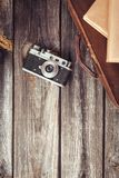 Old retro camera on vintage wooden boards Royalty Free Stock Photos