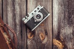 Old retro camera on vintage wooden boards Royalty Free Stock Photography