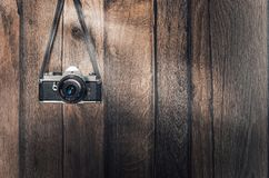 Old retro camera on vintage wooden planks Royalty Free Stock Images