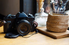 Old retro camera on vintage wooden table Stock Photography