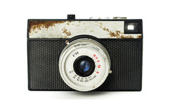 Old retro camera. On a white background Royalty Free Stock Photo