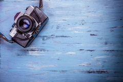 Old retro camera on wooden table background. Old retro camera on vintage wooden table background Stock Photo