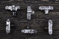 Old retro cameras on vintage wooden background Royalty Free Stock Photo