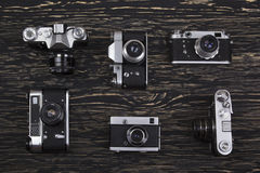 Old retro cameras on vintage wooden background Royalty Free Stock Photography