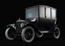 Old retro car on black. Centerdoor sedan Royalty Free Stock Images