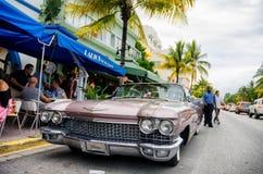 Old retro car parked along ocean dr. street Stock Photos