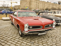 Old retro car Pontiac. MOSCOW - APRIL 21: retro car Pontiac on rally of classical cars on Poklonnaya hill, April 21, 2013, in town Moscow, Russia stock image