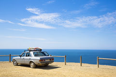Old retro car with surfboards on the roof Stock Images