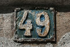 Old retro cast iron plate number 49. Old retro weathered cast iron plate with number 49 closeup Stock Photography