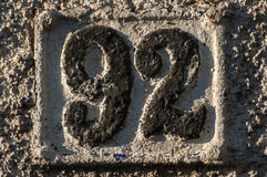 Old retro cast iron plate number 92 Royalty Free Stock Photos