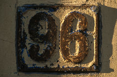 Old retro cast iron plate number 96 Royalty Free Stock Photo