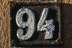 Old retro cast iron plate number 94 Royalty Free Stock Image