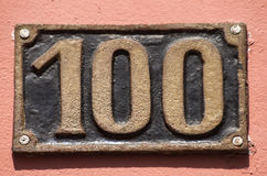 Old retro cast iron plate number 100 Stock Photos