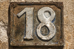 Old retro cast iron plate number 18 Stock Photos