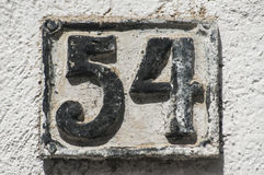 Old retro cast iron plate number 54 Stock Photography