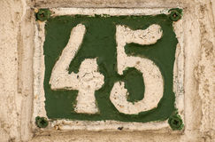 Old retro cast iron plate number 45 Royalty Free Stock Photos