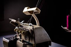 Technology of Old retro classic sewing machine on wood. royalty free stock photography