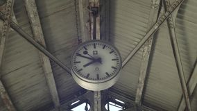 Old Retro Clock On Station. Timelapse shot of the time is ticking at old clock on railroad station stock footage
