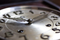 Old or retro clock winding, close-up hands and face of the old m Royalty Free Stock Photography