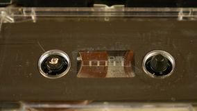 Old retro compact cassette vintage audio recorder. Old retro compact cassette audio recorder reels spinning. Music vintage scene stock video footage