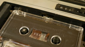 Old retro compact cassette vintage audio recorder. Old retro compact cassette audio recorder reels spinning. Music vintage scene stock footage