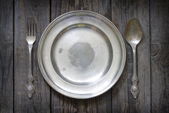Old retro cutlery and plate on vintage planks Stock Photography
