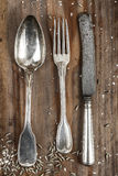 Old Retro cutlery set on vintage wooden background Stock Photos