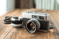 Old retro Film camera on wooden background Royalty Free Stock Photos