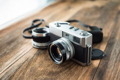 Old retro Film camera on wooden background Stock Images