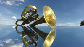 Old retro golden musical brass wind instrument on mirror. Timelapse 4K stock footage