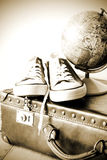 Old retro holiday suitcase and shoes for globetrotter Royalty Free Stock Photography