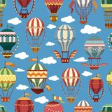 Old or retro hot air transport or striped balloons. Hot air montgolfier balloons in sky with clouds. Old or vintage, retro flying striped transport for journey Royalty Free Stock Image
