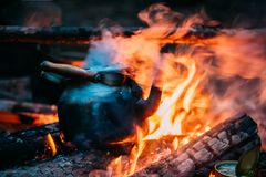 Old Retro Iron Camp Kettle Boiling Water On A Fire In Forest. Stock Photos