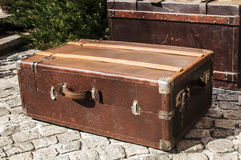 Old retro leather suitcases. Old closet locked retro vintage leather suitcases on stone paved surface closeup Royalty Free Stock Photography